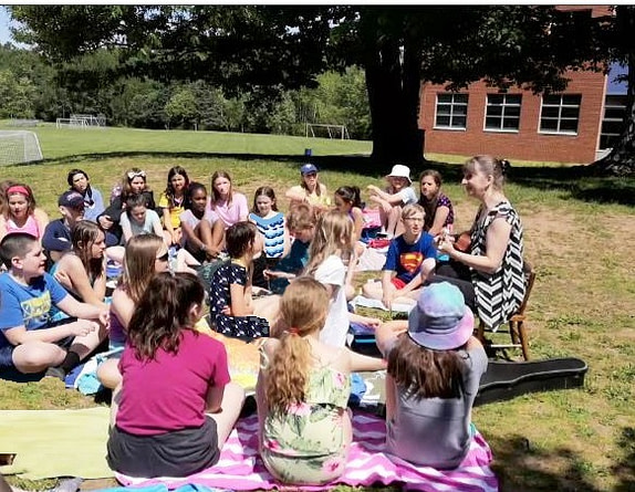 Donna Rhodenizer - teaching music class outdoors