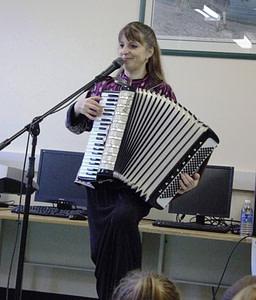 Donna Rhodenizer - plays accordion in school performance